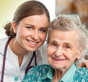 Photo of elderly person with nurse